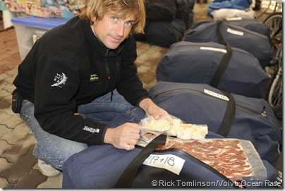 Telefonica Blue media crew member Gabriele Olivo prepares the food for leg 5 of VOR