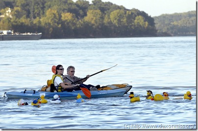 ELIZABETH DODD ~ edodd@semissourian.com Casey Zimmerman, of Cape Girardeau, left, and Don Greenwood, of Cape Girardeau start the first duck race with the sponser ducks at the first annual Ducks on the Mississippi in downtown Cape Girardeau Friday. About 700 ducks participated and proceeds from the event went to Optimist International for Childhood Cancer and local children programs. The event was in honor of Janie Meyer, who passed away from cancer in May. Meyer was the president of the Espirit Optimist Club.