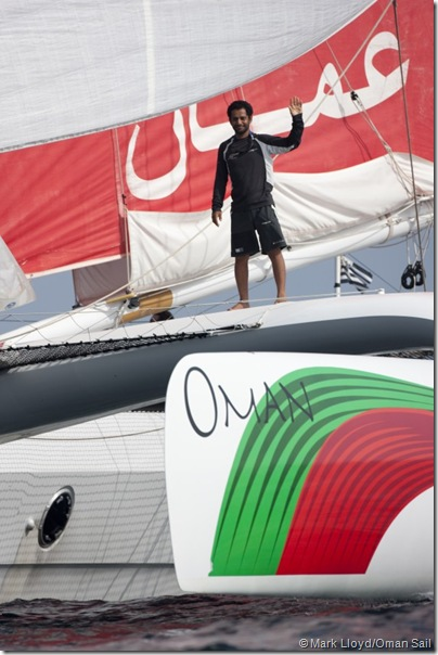 "Pictures of ""Musandam"" the Oman Sail trimaran and her crew as they celebrate after crossing the finish line"